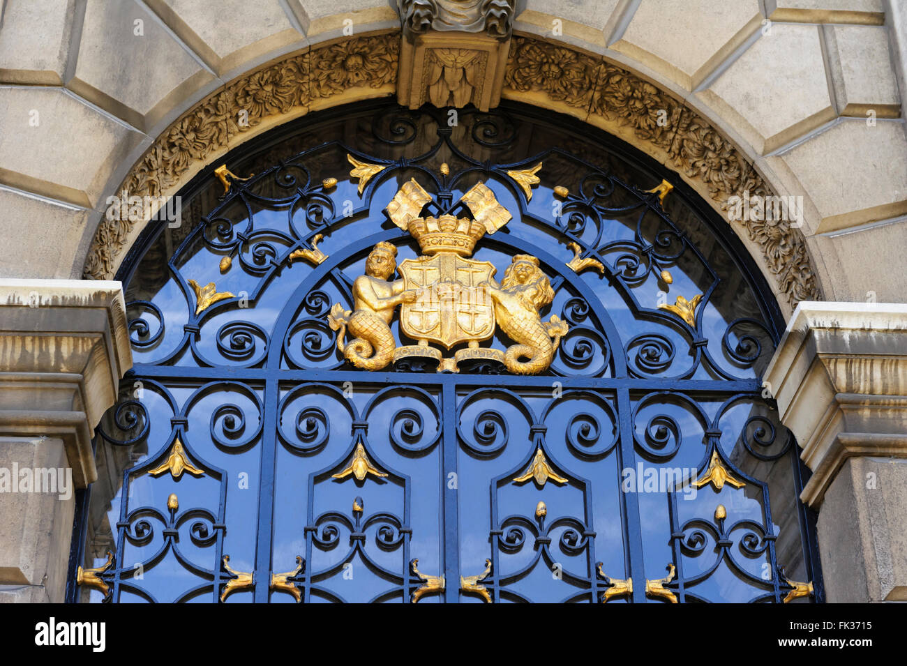 Symbolic Coat of Arms above the doorway of one of the entrances to the historic Old Royal Naval College, London, Stock Photo