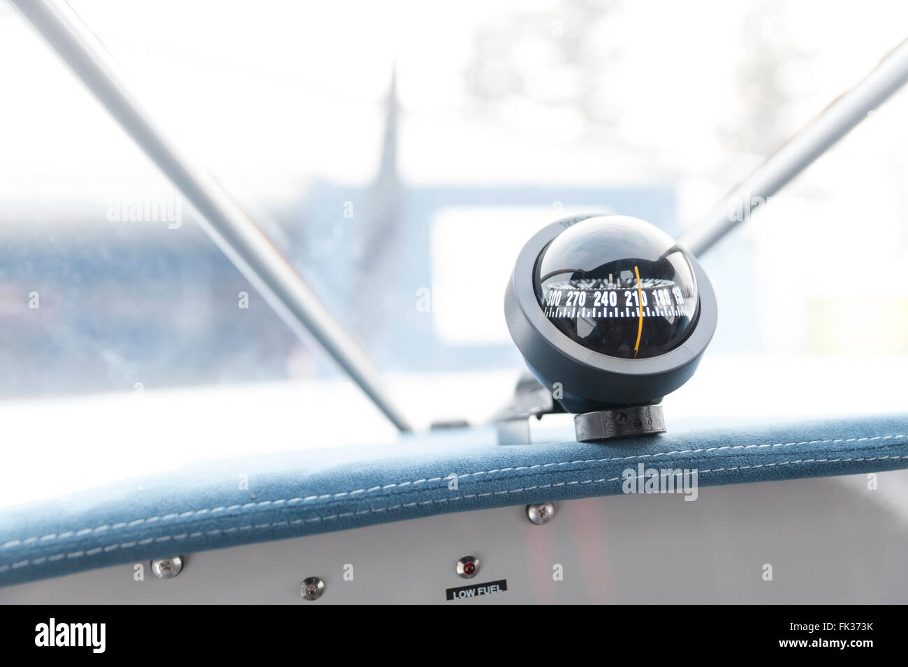 compass in airplane close up - Stock Image