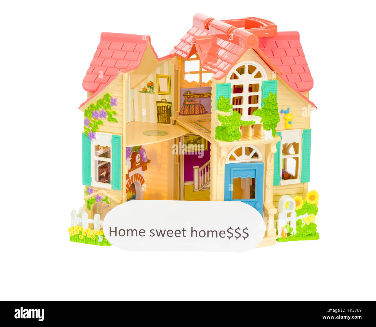 Doll House with a home sweet home sign - Stock Image