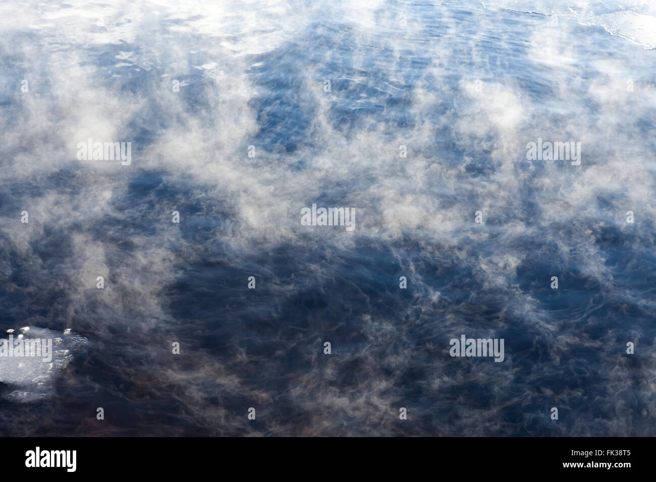 Water vapor on surface of cold water - Stock Image
