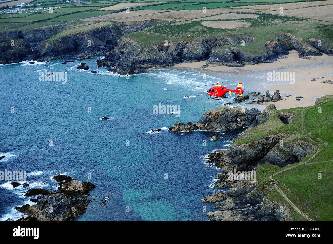 Air Ambulance flying over north coast of Cornwall - Stock Image