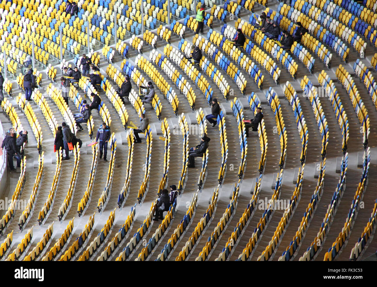 KYIV, UKRAINE - NOVEMBER 11, 2011: People fill the tribunes at the Olympic stadium (NSC Olimpiysky) before friendly - Stock Image