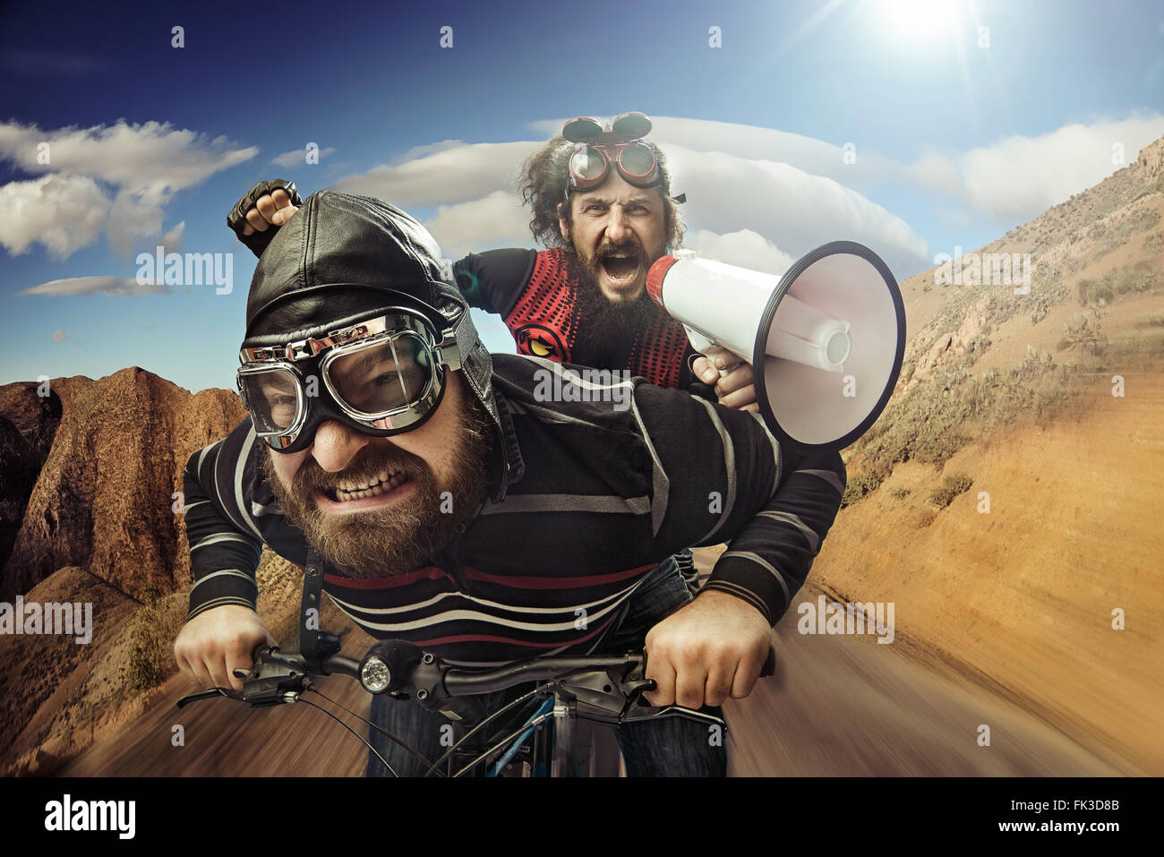 Funny portrait of a tandem of bicyclists - Stock Image
