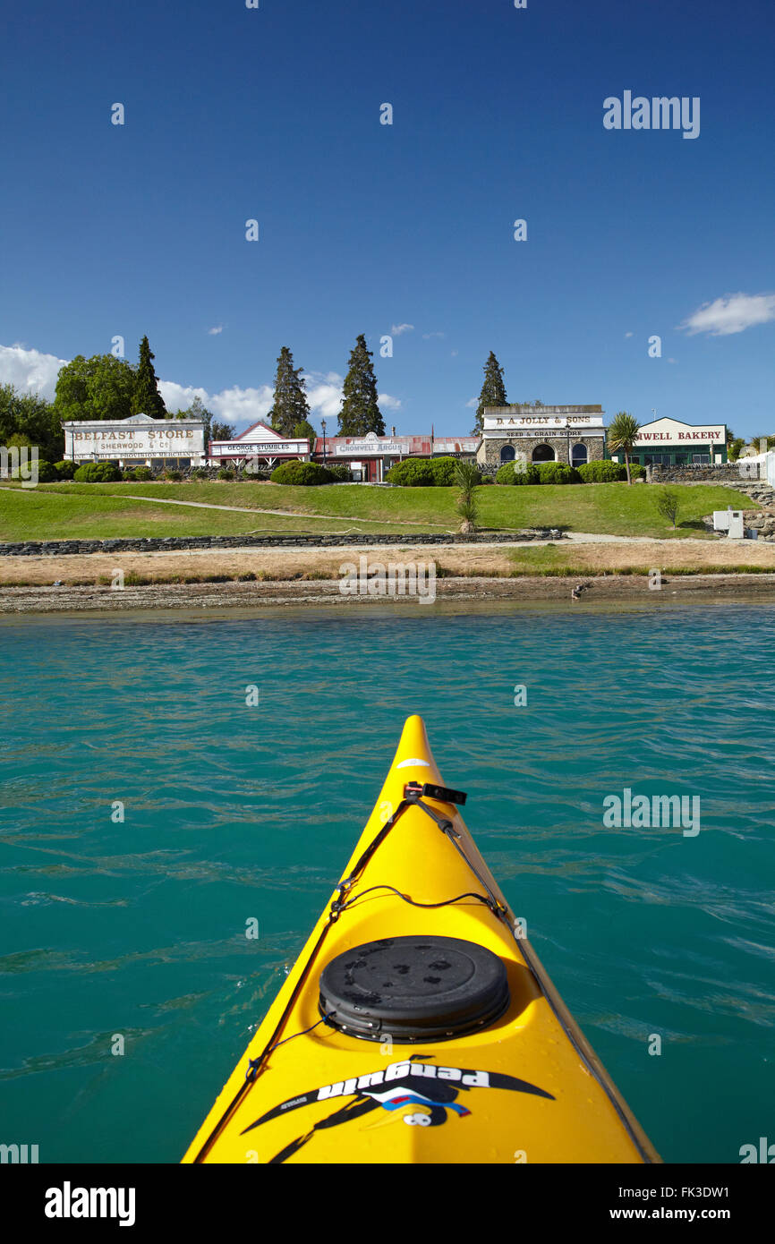 Kayak, Lake Dunstan and historic buildings at Old Cromwell Town, Central Otago, South Island, New Zealand - Stock Image