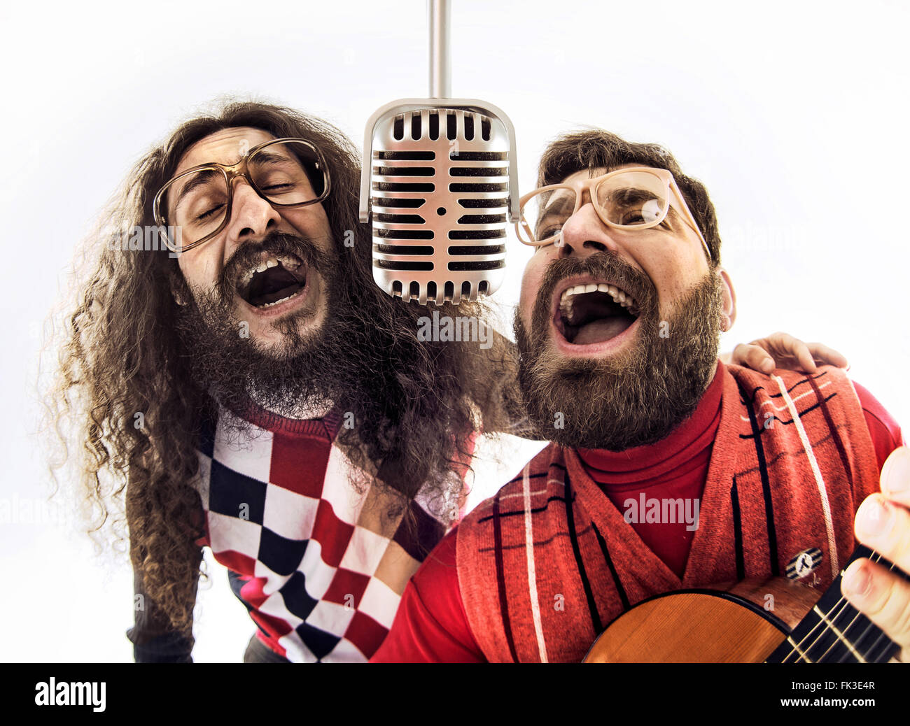 Two nerdy boys singing together - Stock Image