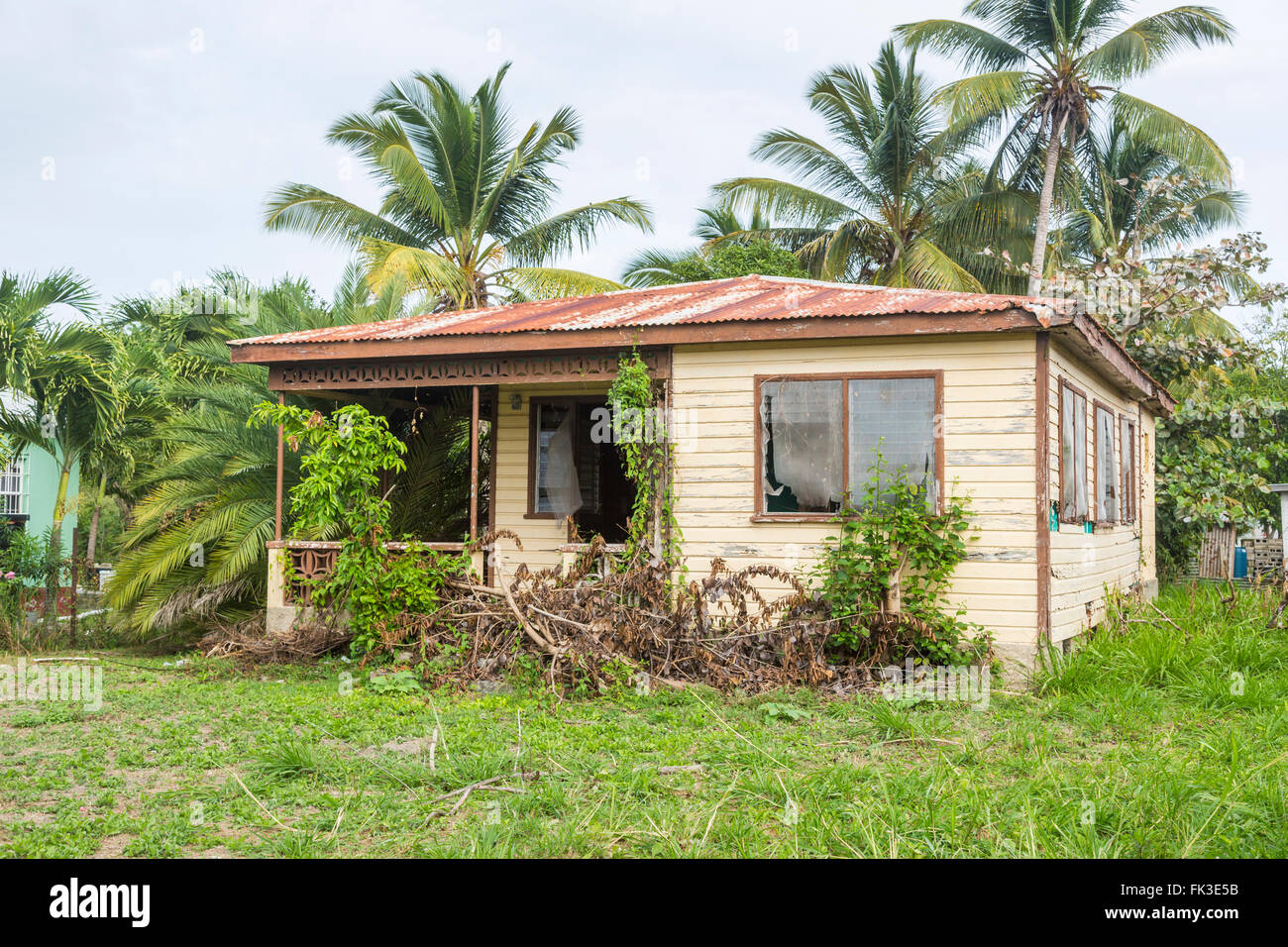 Typical run-down, dilapidated wooden single storey house in Liberta, south Antigua, Antigua and Barbuda, West Indies - Stock Image