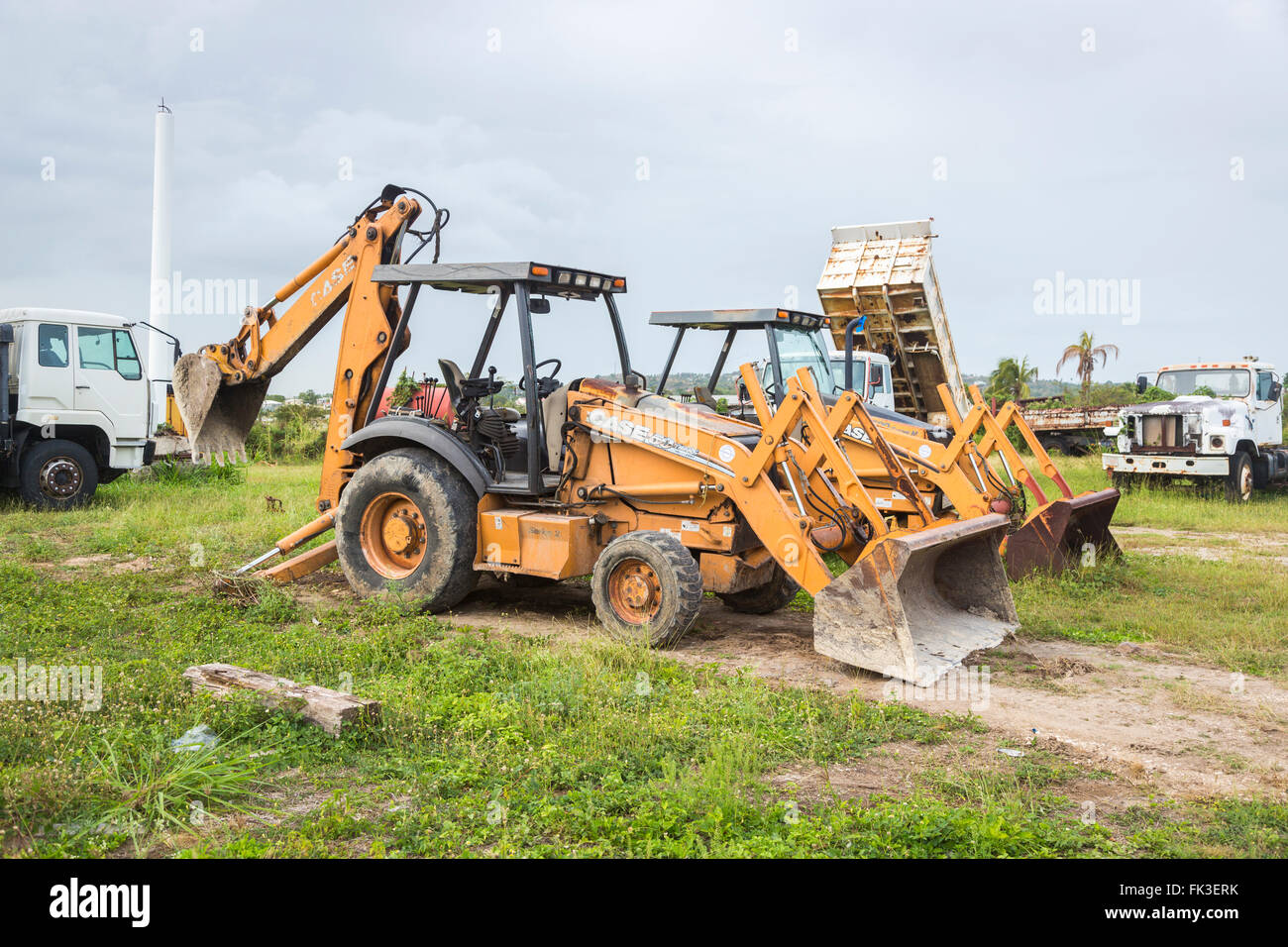 Yellow Case Manufacturers digger in Ogg Spencer's Trucking scrapyard, Liberta, south Antigua, Antigua and Barbuda, - Stock Image