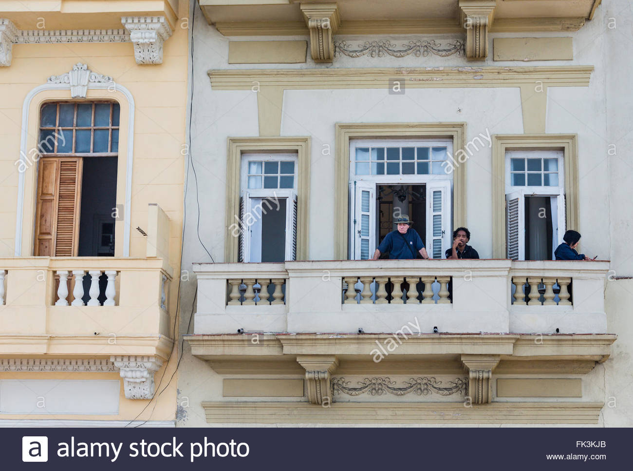 Tourists in balcony of hostal or private rented house. The hostal are very successful private business in the Caribbean - Stock Image