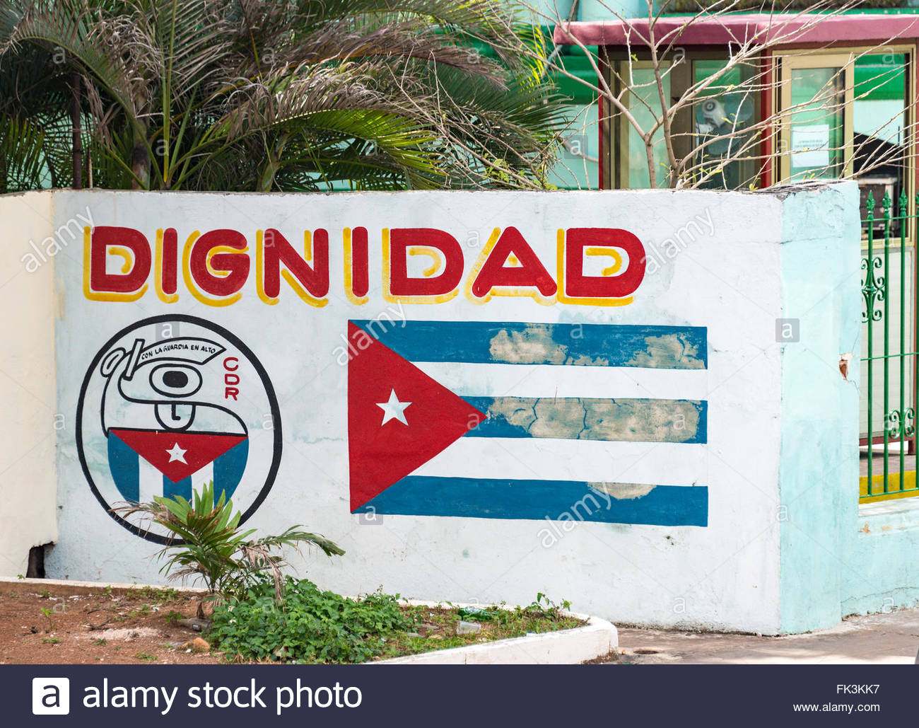 CDR or Revolution Defense Committee sign along a Cuban flag and the word Dignity, all painted in a wall - Stock Image