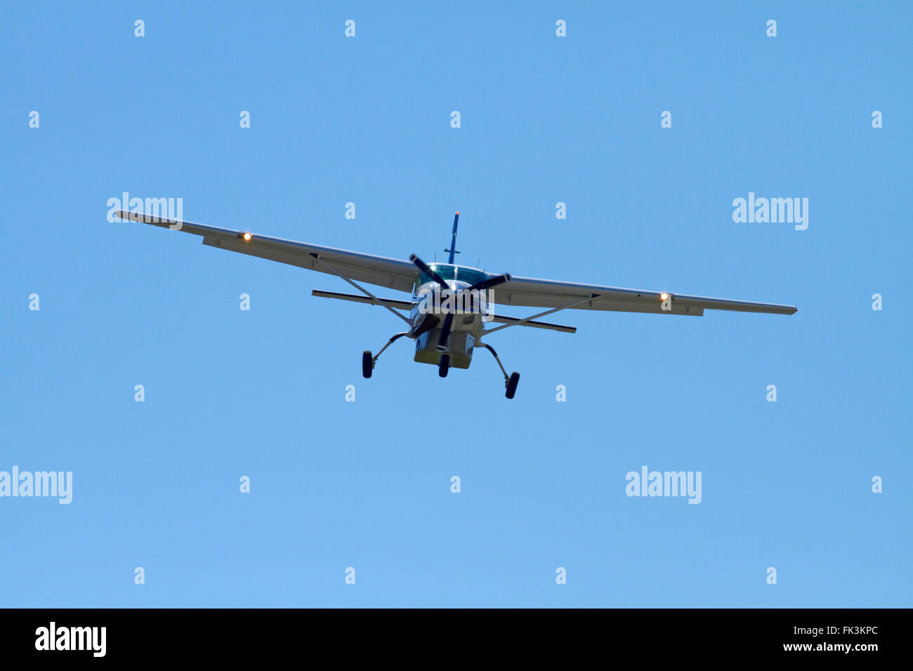 Air Milford tourist plane (Cessna 208) landing at Queenstown Airport, Otago, South Island, New Zealand - Stock Image
