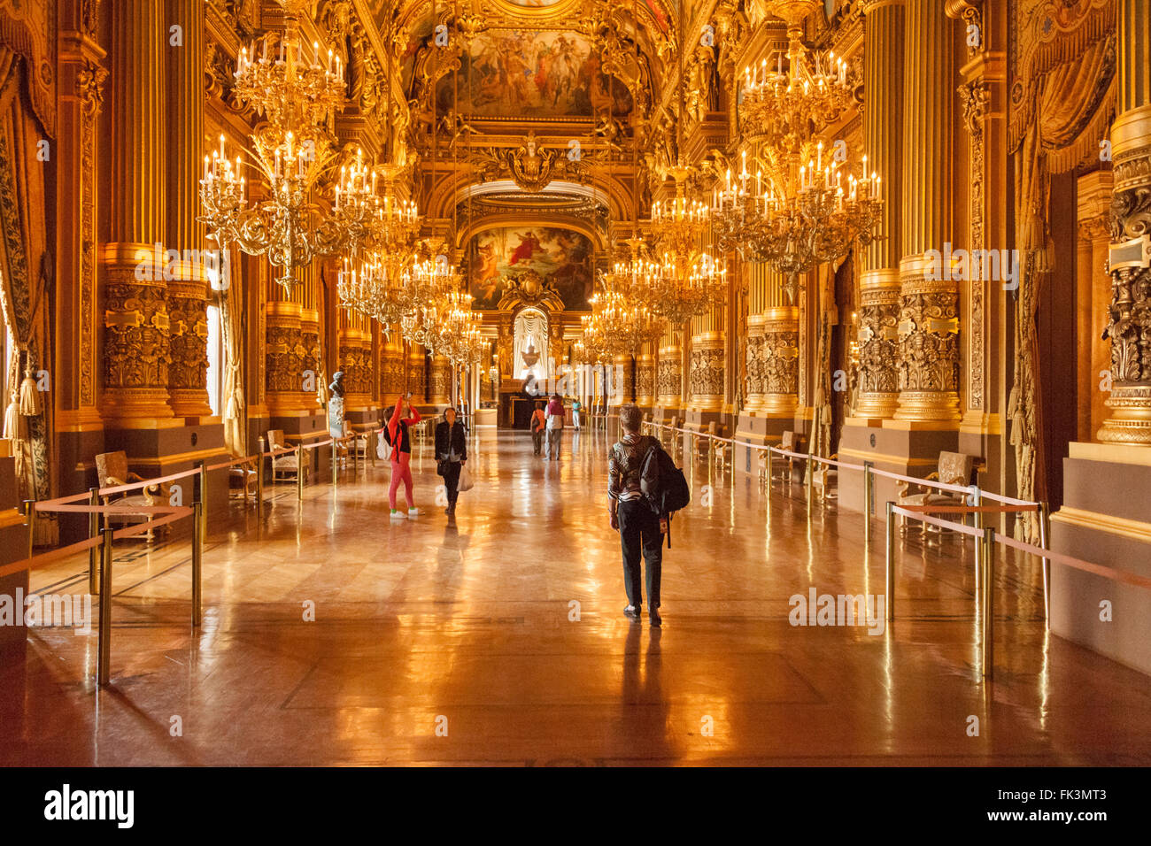 Tourists in Le Grand Foyer of Palais Granier in the Paris Opera House - Stock Image