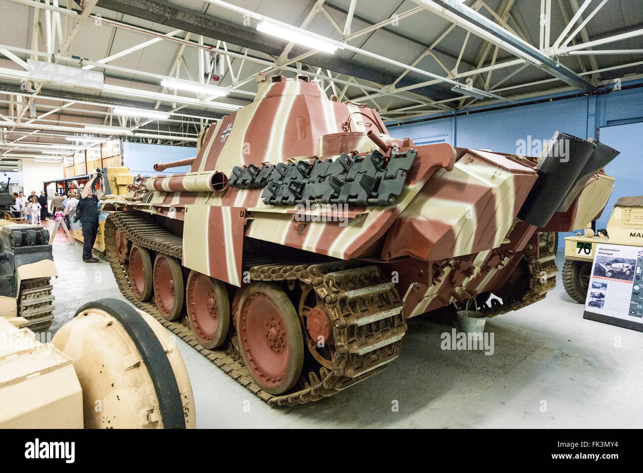 Bovington tank museum interior. Rear view showing exhausts of World war two German Panzer V, Panther tank, displayed - Stock Image