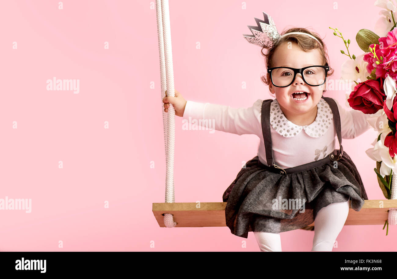 Portrait of a cute toddler wearing eyeglasses - Stock Image