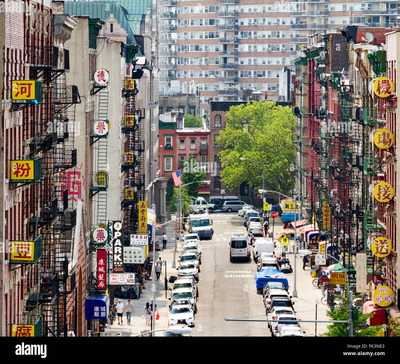 NEW YORK CITY - JULY 2015: Cars and signs line a busy street in Chinatown during the Fourth of July holiday in Manhattan, Stock Photo