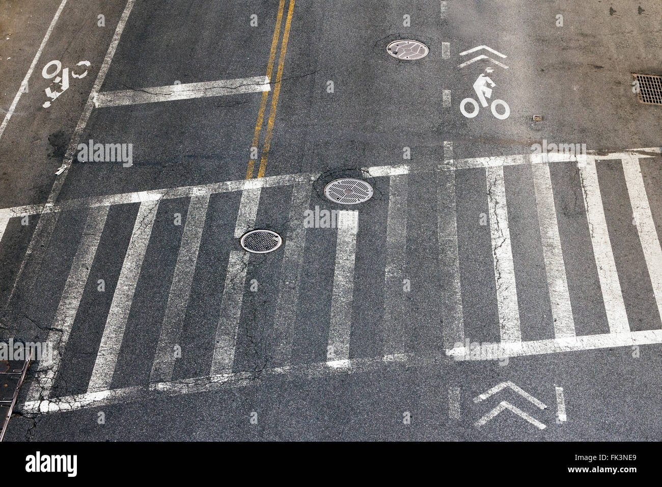 City street crosswalk and bike lanes in New York City - Stock Image