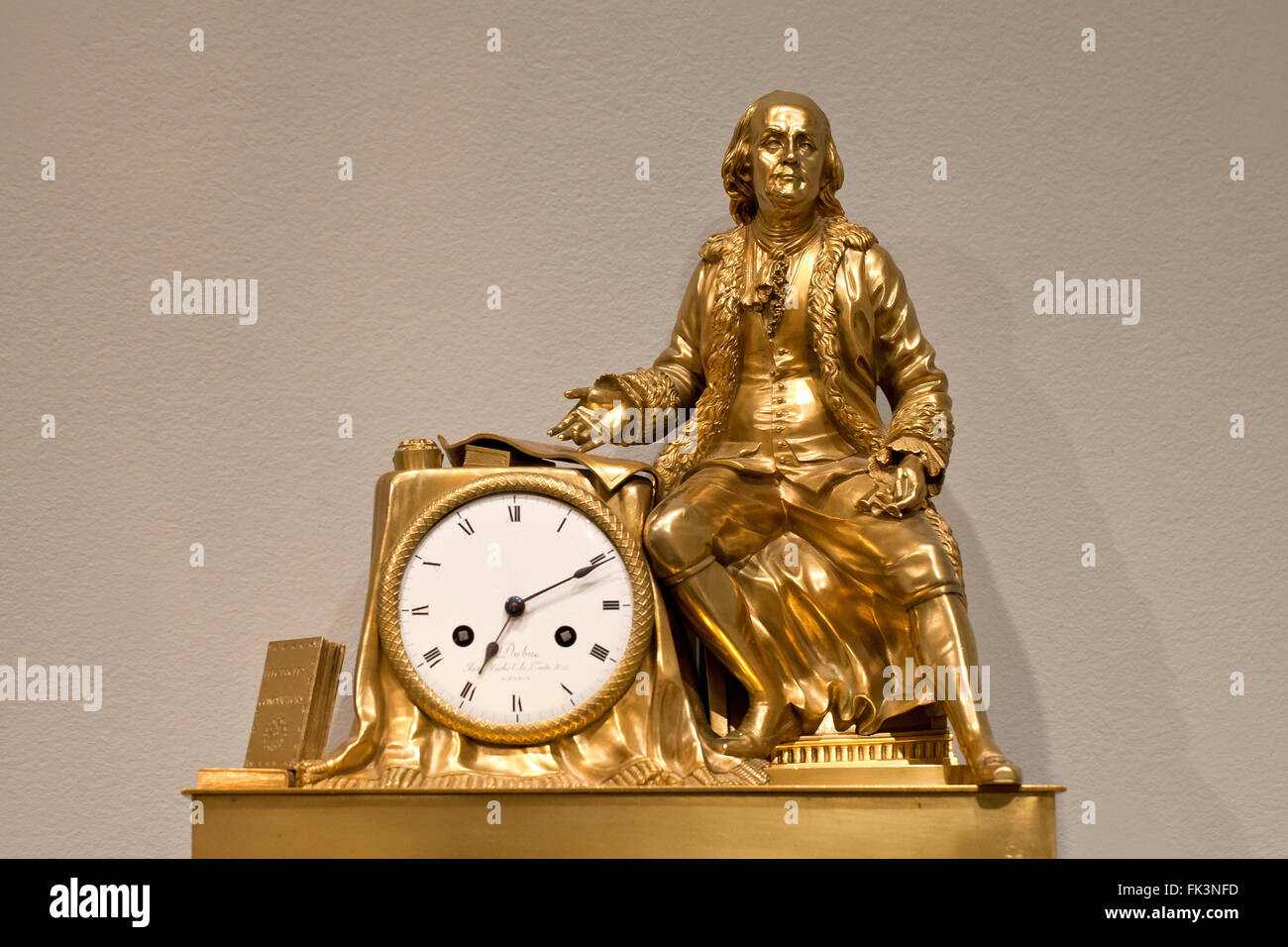 Gilded brass antique mantel clock, circa 1815 - USA - Stock Image