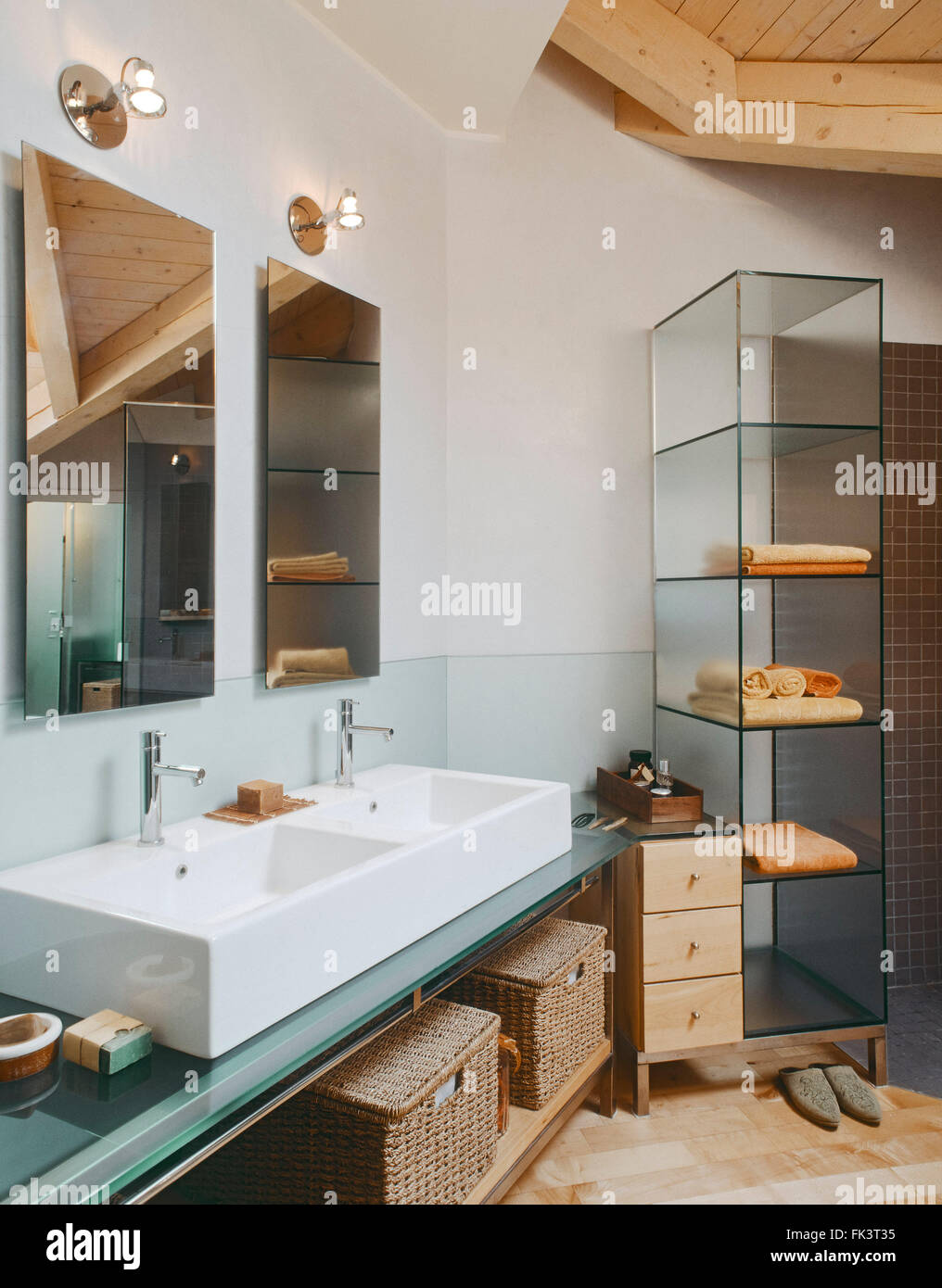 interior view of a modern bathroom in the attic room in foreground two washbasin - Stock Image