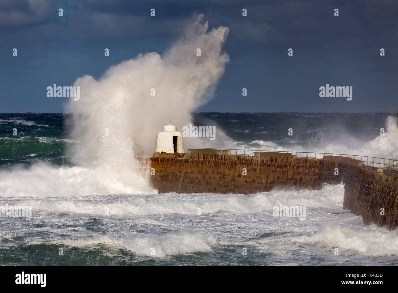 Portreath; Wave breaking Pier; Cornwall; UK - Stock Image