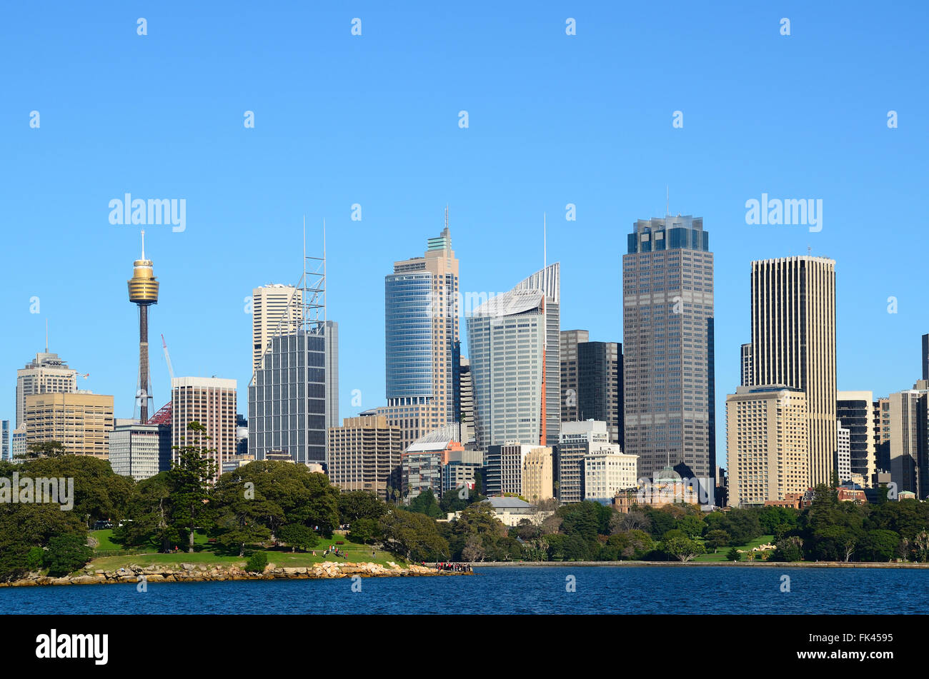 View from water on the sydney cbd with sydney tower and skyscrapers and royal botanic garden with tourists Stock Photo