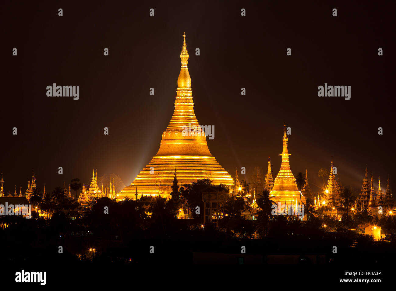 Shwedagon Pagoda in Yangon City, Burma with Beautiful Evening Light: the beautiful golden pagoda, - Stock Image