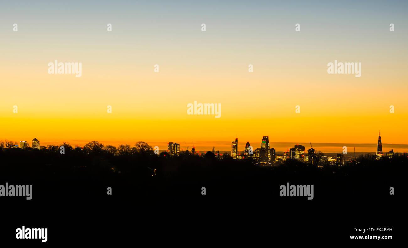 Golden sunrise over the London skyline taken from Hampstead Heath. - Stock Image