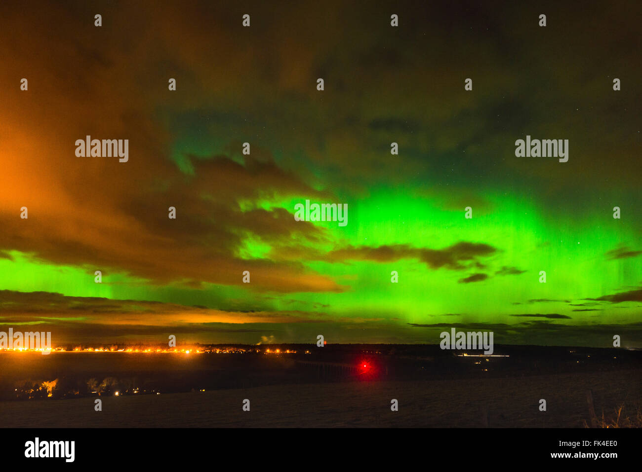 The Aurora Borealis (Northern Lights) light up the sky above Inverness in the Highlands of Scotland. The Aurora Stock Photo