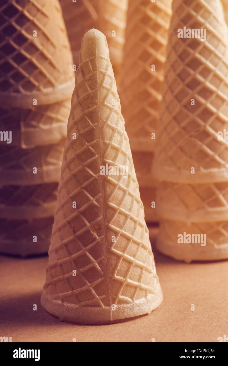 Crispy ice cream cone stack, warm retro tone, soft light - Stock Image