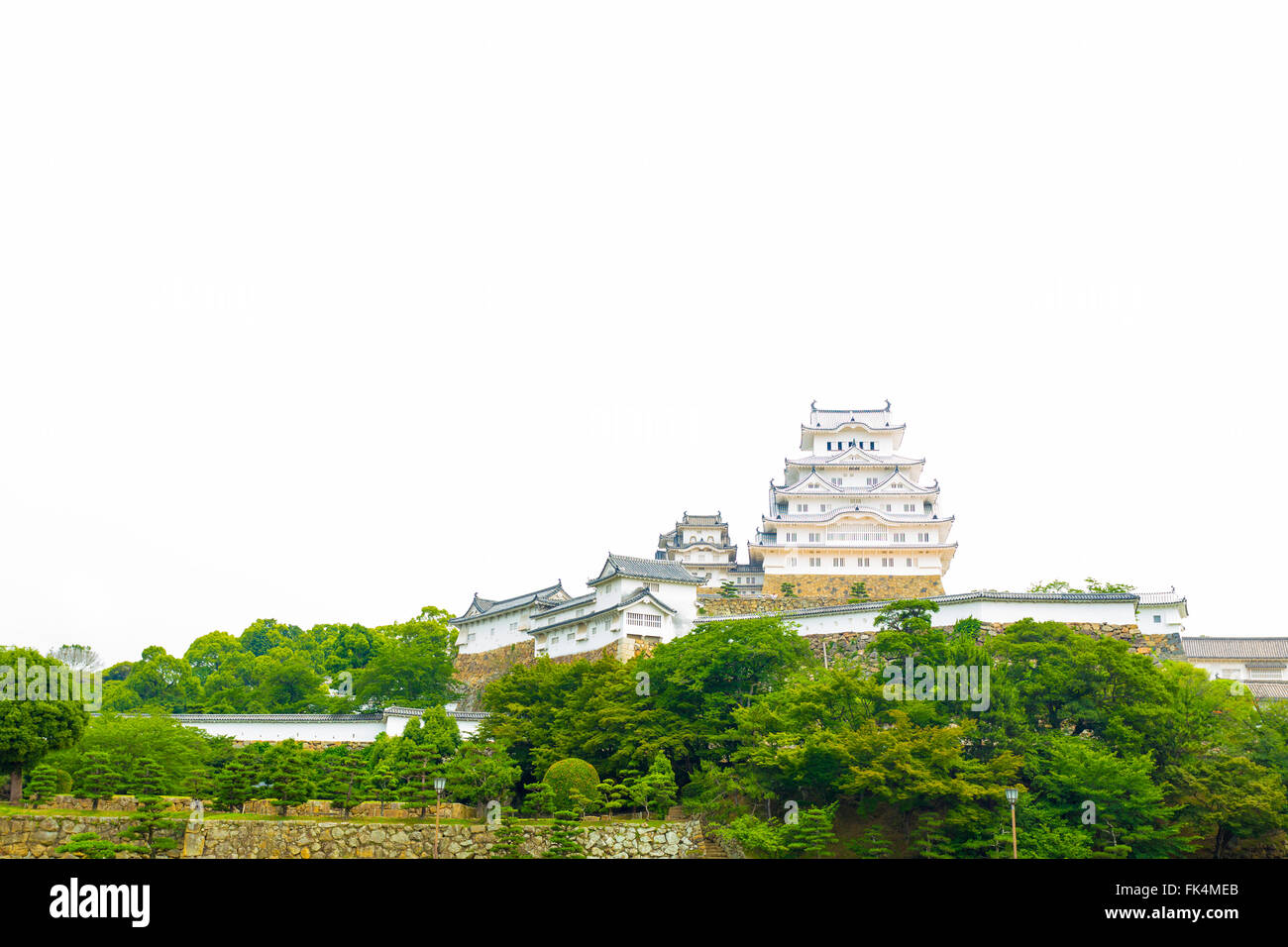 Distant view of front facade of Himeji-jo castle on bright overcast day in Himeji, Japan after 2015 renovations - Stock Image