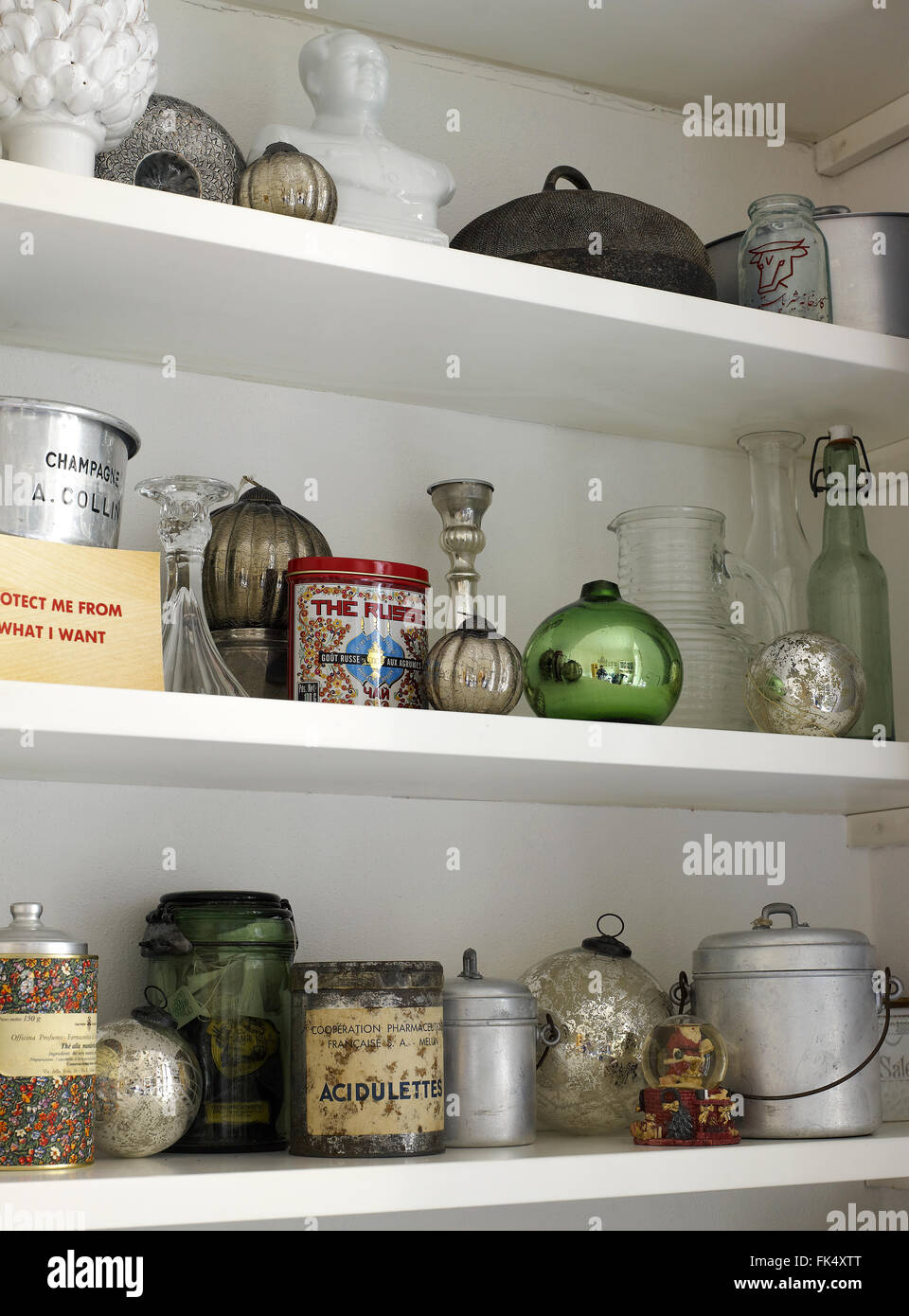 Home Decoration for Christmas, shelves of a cupboard decorated with objects, fruit, , bottles, cans. tins, - Stock Image