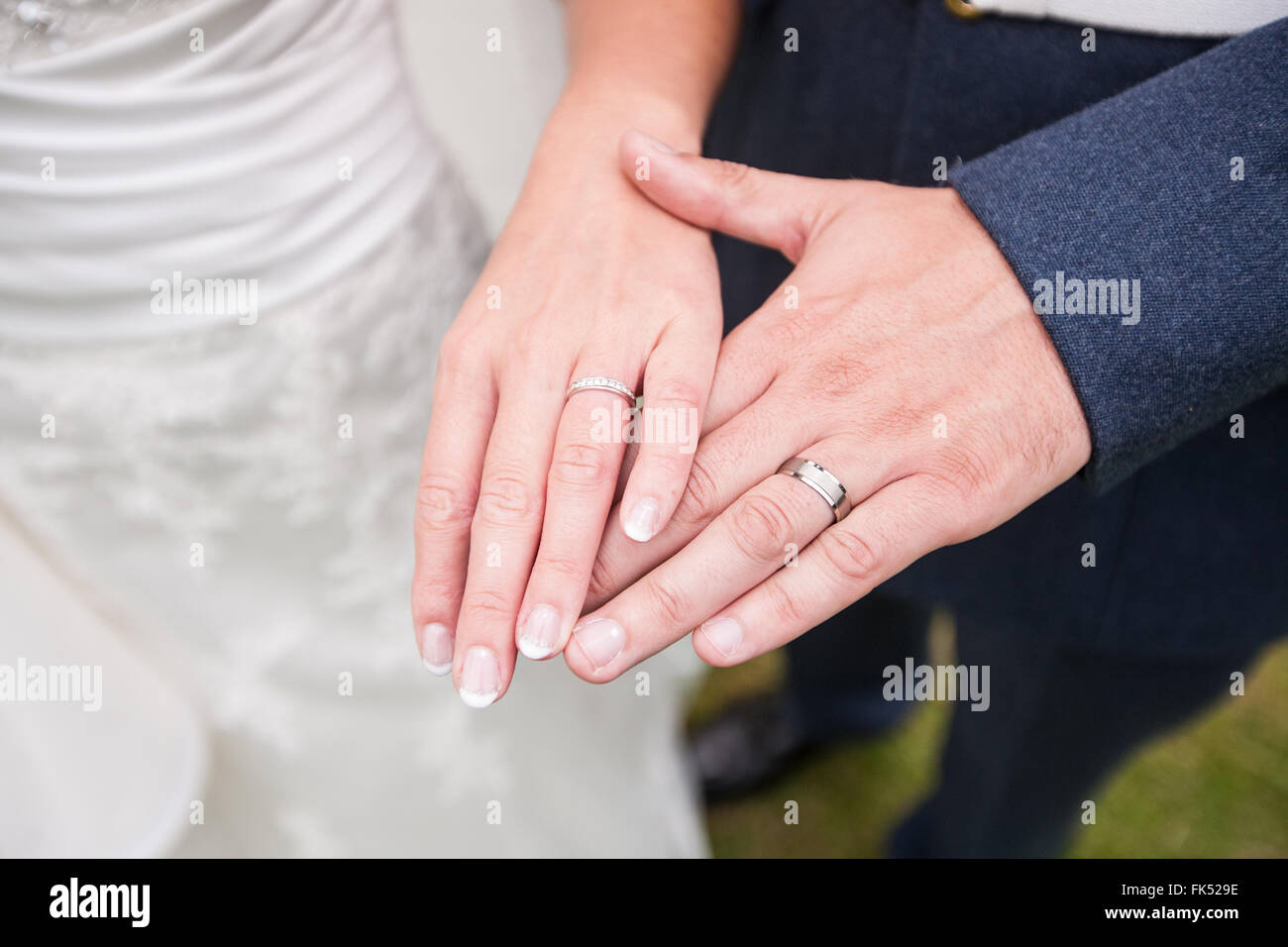 Wedding Rings Hands With Red Flowers Stock Photos & Wedding Rings ...