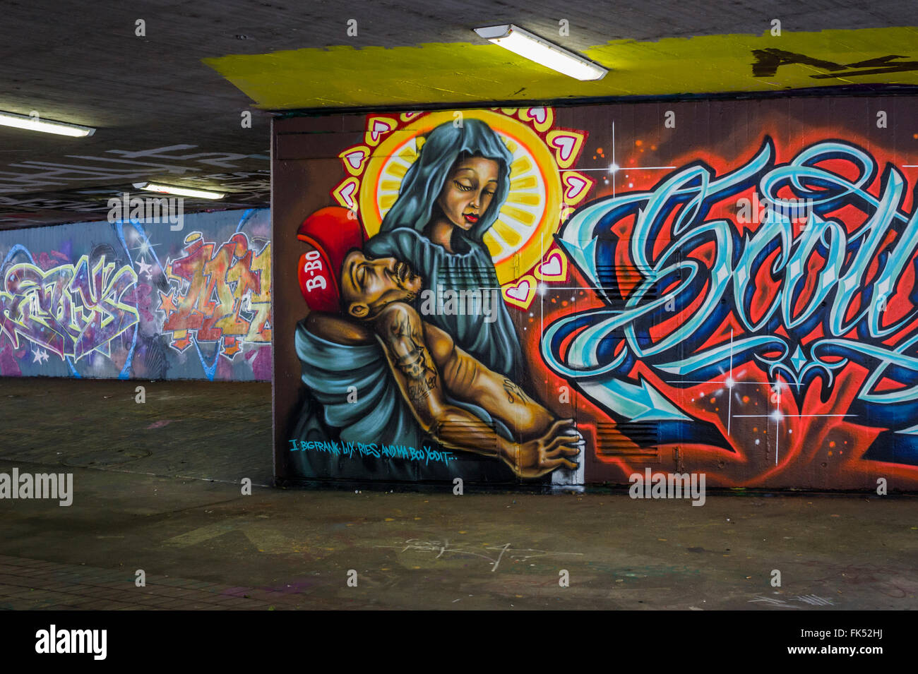 graffito gangster-pietà - Stock Image
