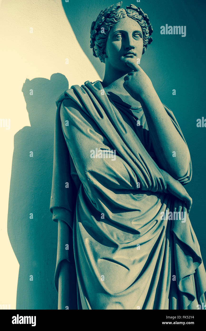 classical sculpture of a female figure lost in thought - Stock Image