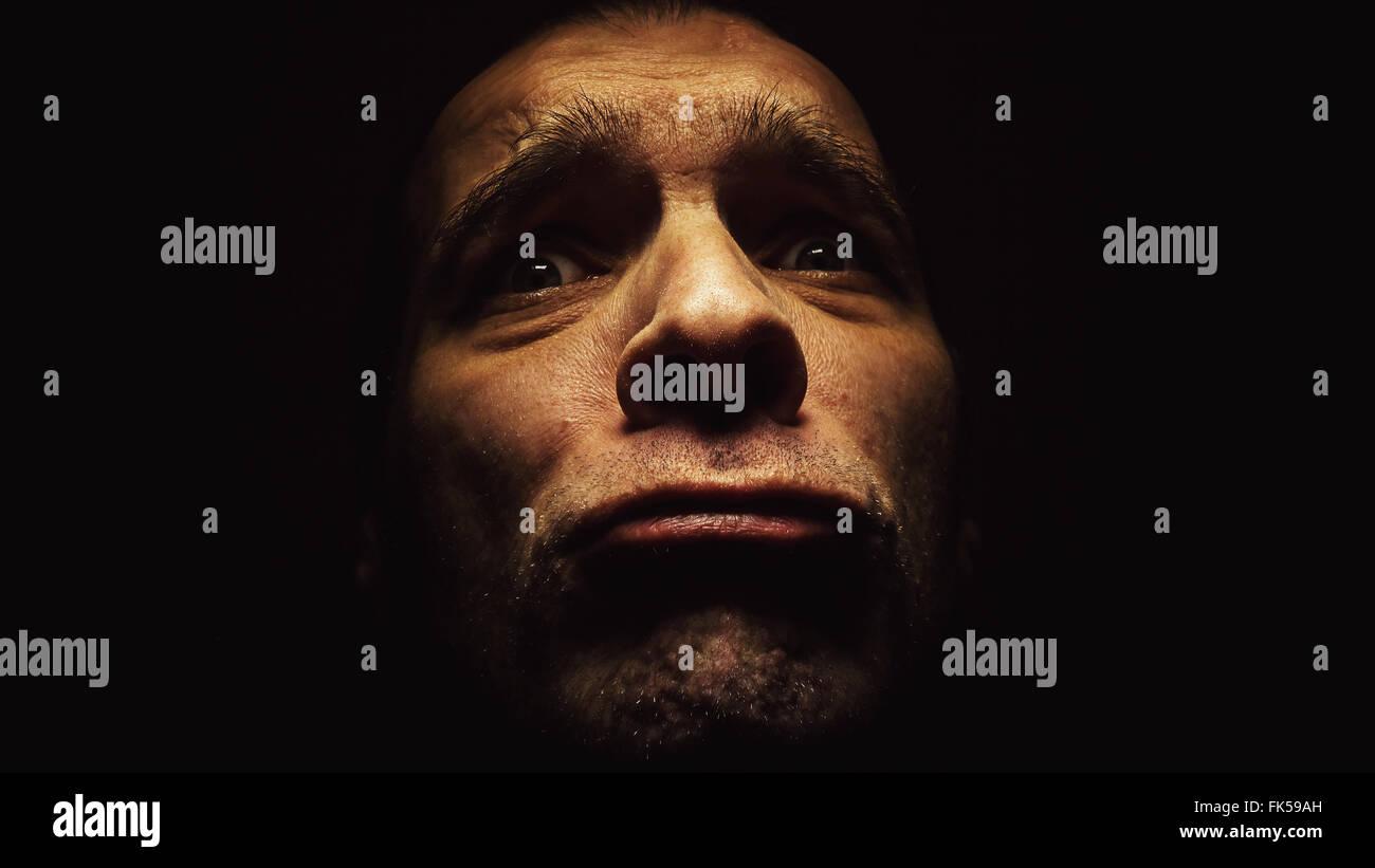 Face expression, portrait of afraid man's face. - Stock Image