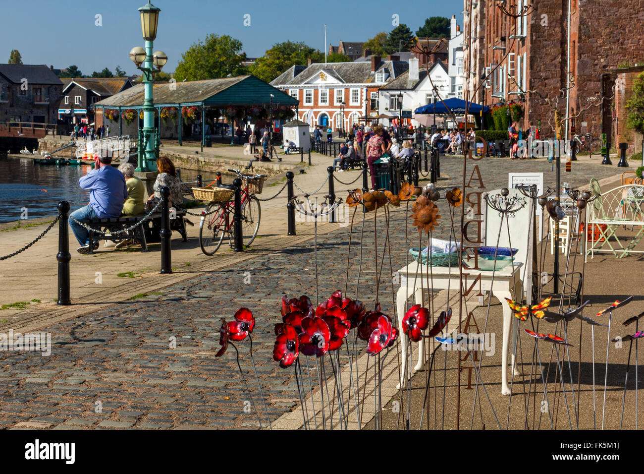 Colorful Ceramics at The Historic Old Cellars with River Exe and Visitors enjoying a Sunny Autumn Afternoon, Exeter - Stock Image