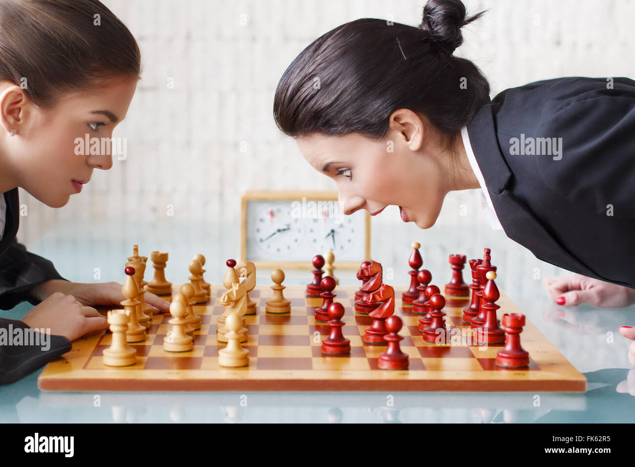 Young women playing chess, tactics, queen gambit - Stock Image