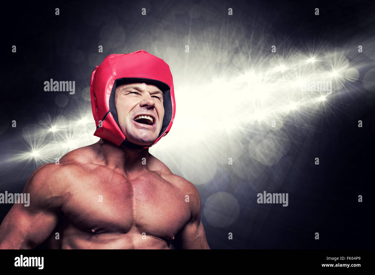Composite image of angry boxer with headgear - Stock Image