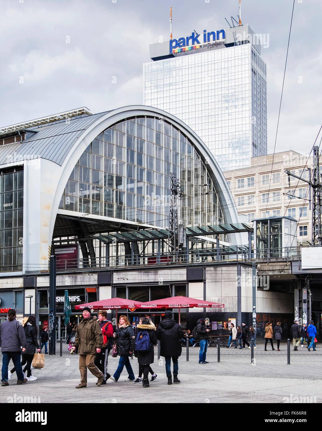 Berlin Alexanderplatz S-bahn railway station exterior and Park Inn - Stock Image