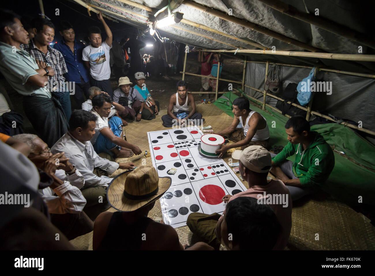 Mrauk U, gambling at Dung Bwe Festival for the passing of an important Buddhist Monk, Rakhine State, Myanmar (Burma), - Stock Image