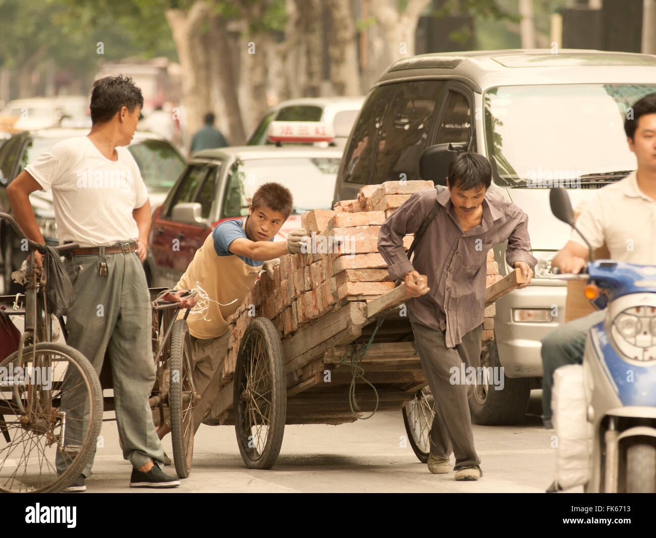 Busy street scene, showing the traditional and the new, Shanghai, China, Asia - Stock Image