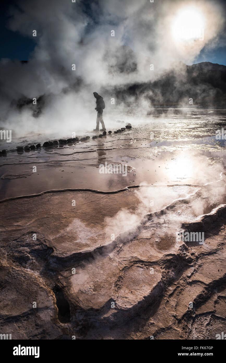 Tourist at El Tatio Geysers (Geysers del Tatio), the largest geyser field in the Southern Hemisphere, Atacama Desert, - Stock Image