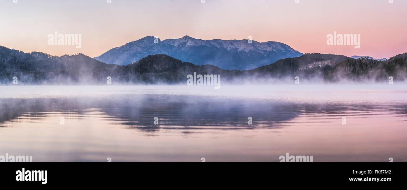 Misty sunrise at Nahuel Huapi Lake (Lago Nahuel Huapi), Villa la Angostura, Neuquen, Patagonia, Argentina, South - Stock Image