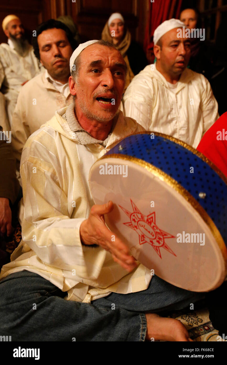 Alawi Sufi Muslims singing and playing drums, Nandy, Seine-et-Marne, France, Europe - Stock Image
