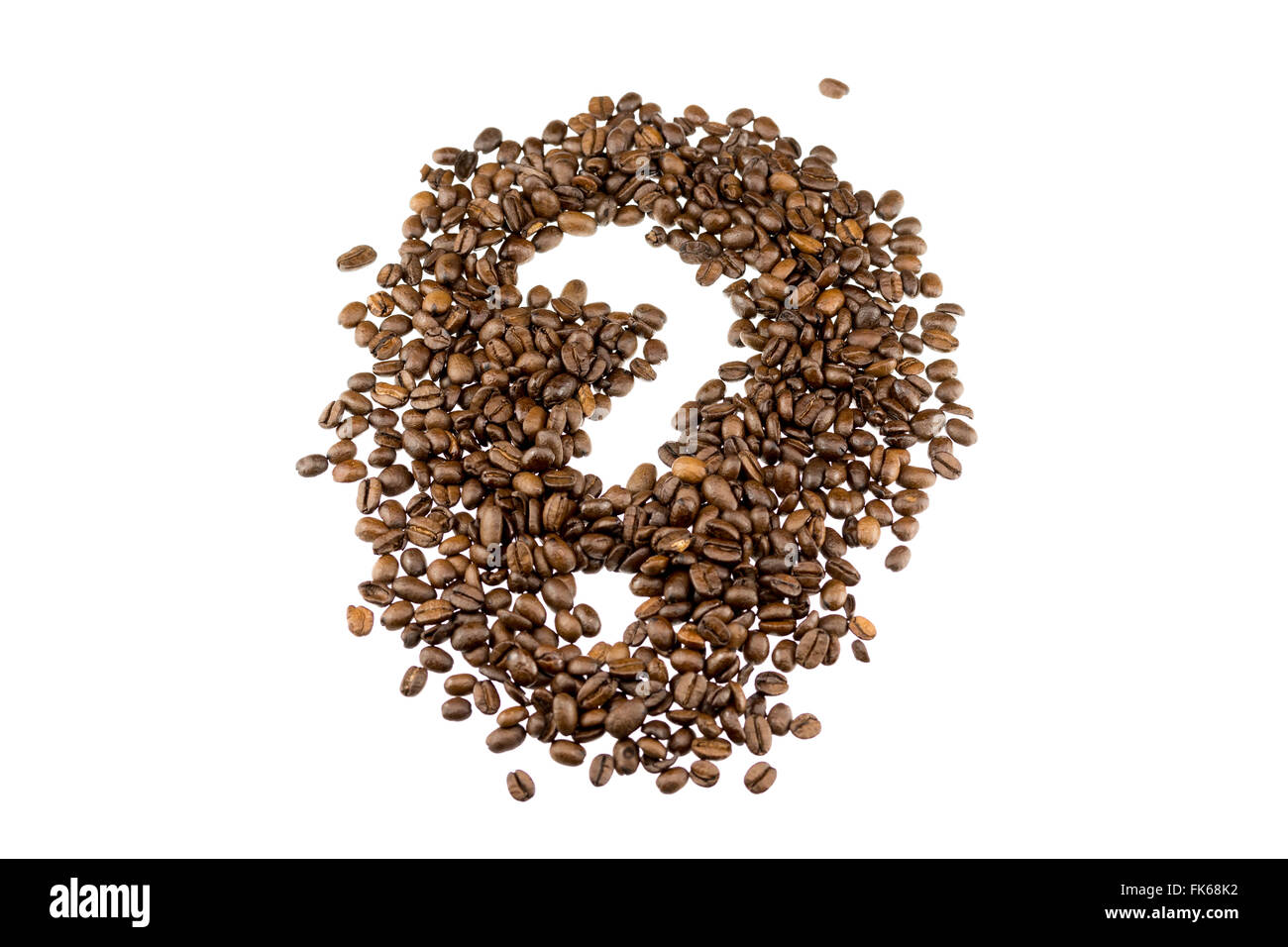 a question mark in coffe beans on a white background - Stock Image