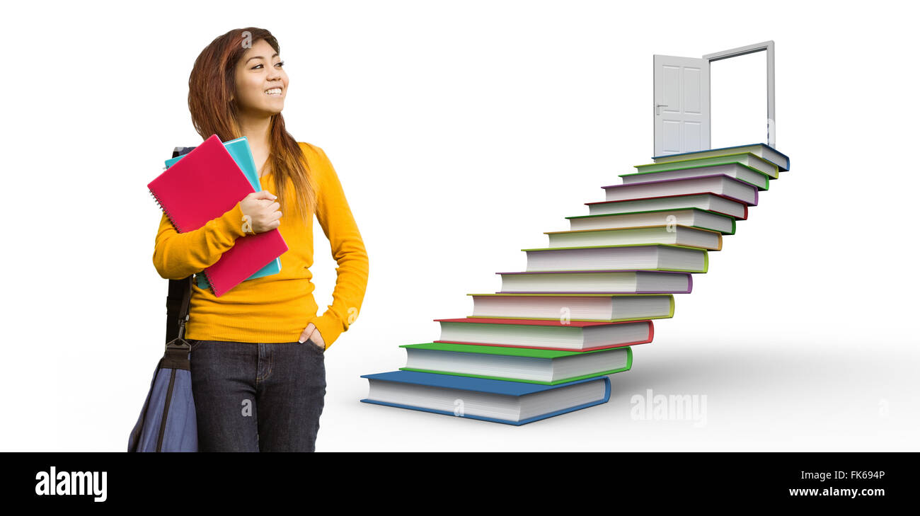 Composite image of female college student with books in park - Stock Image