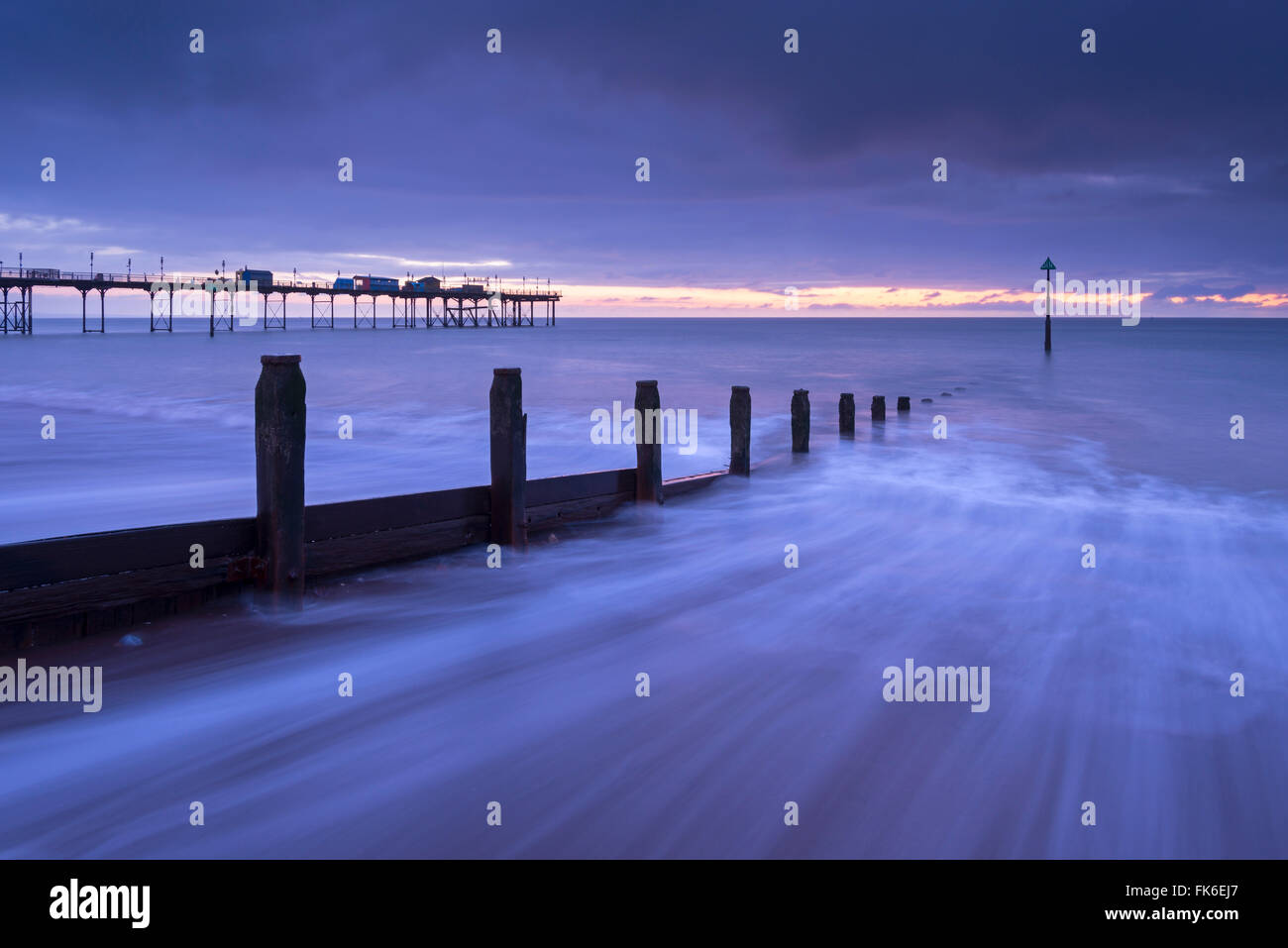 Waves rush over the beach at Teignmouth at dawn in winter, Devon, England, United Kingdom, Europe - Stock Image
