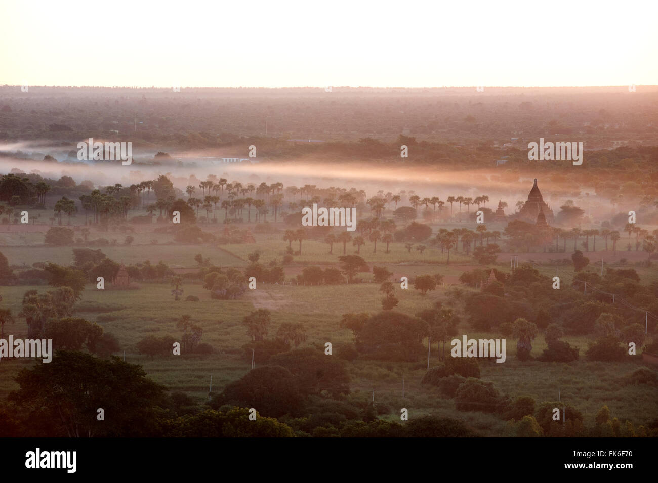 Mists from the nearby Irrawaddy River floating across Bagan (Pagan), Mandalay Division, Myanmar (Burma), Asia - Stock Image