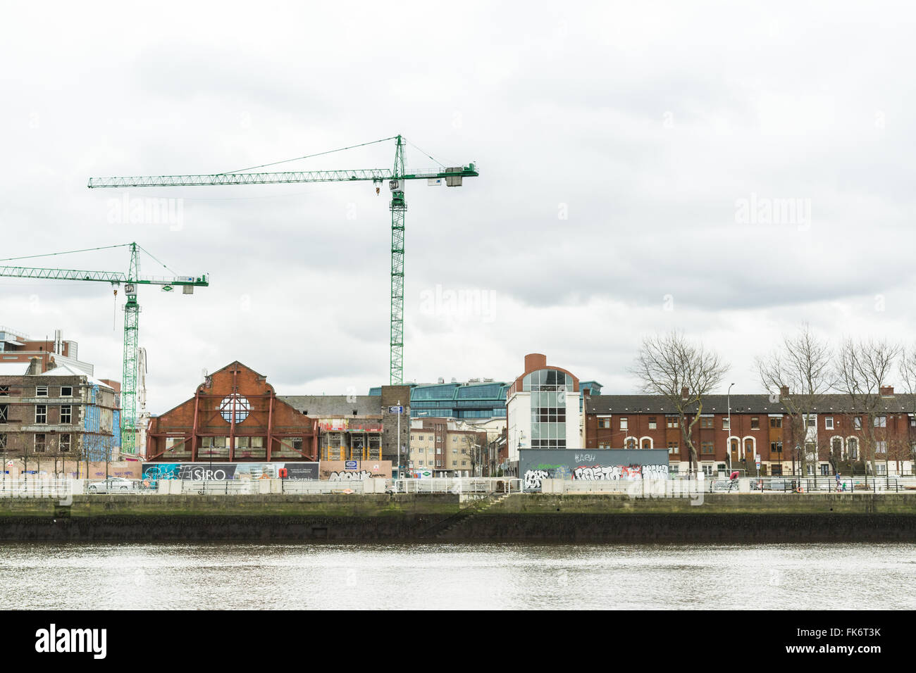 Saved Dublin Tramway facade surrounded by development works, Sir John Rogerson's Quay, SOBO District, Dublin, - Stock Image
