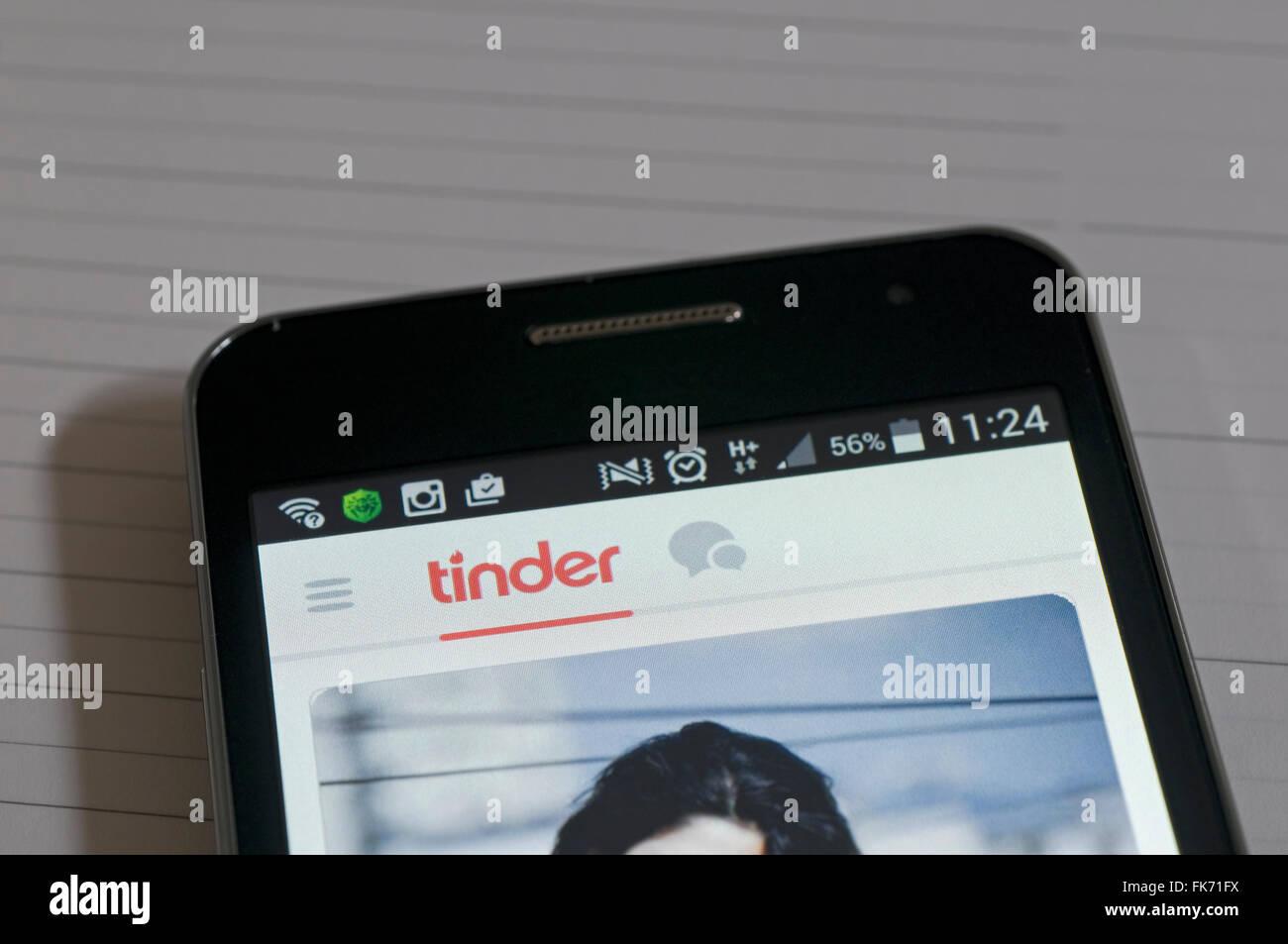 Tinder dating app on smartphone - Stock Image
