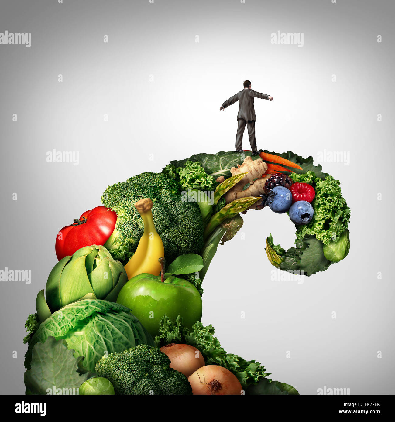 Healthy living movement as a person on top of a group of vegetables and fruit shaped as a wave or tide representing - Stock Image