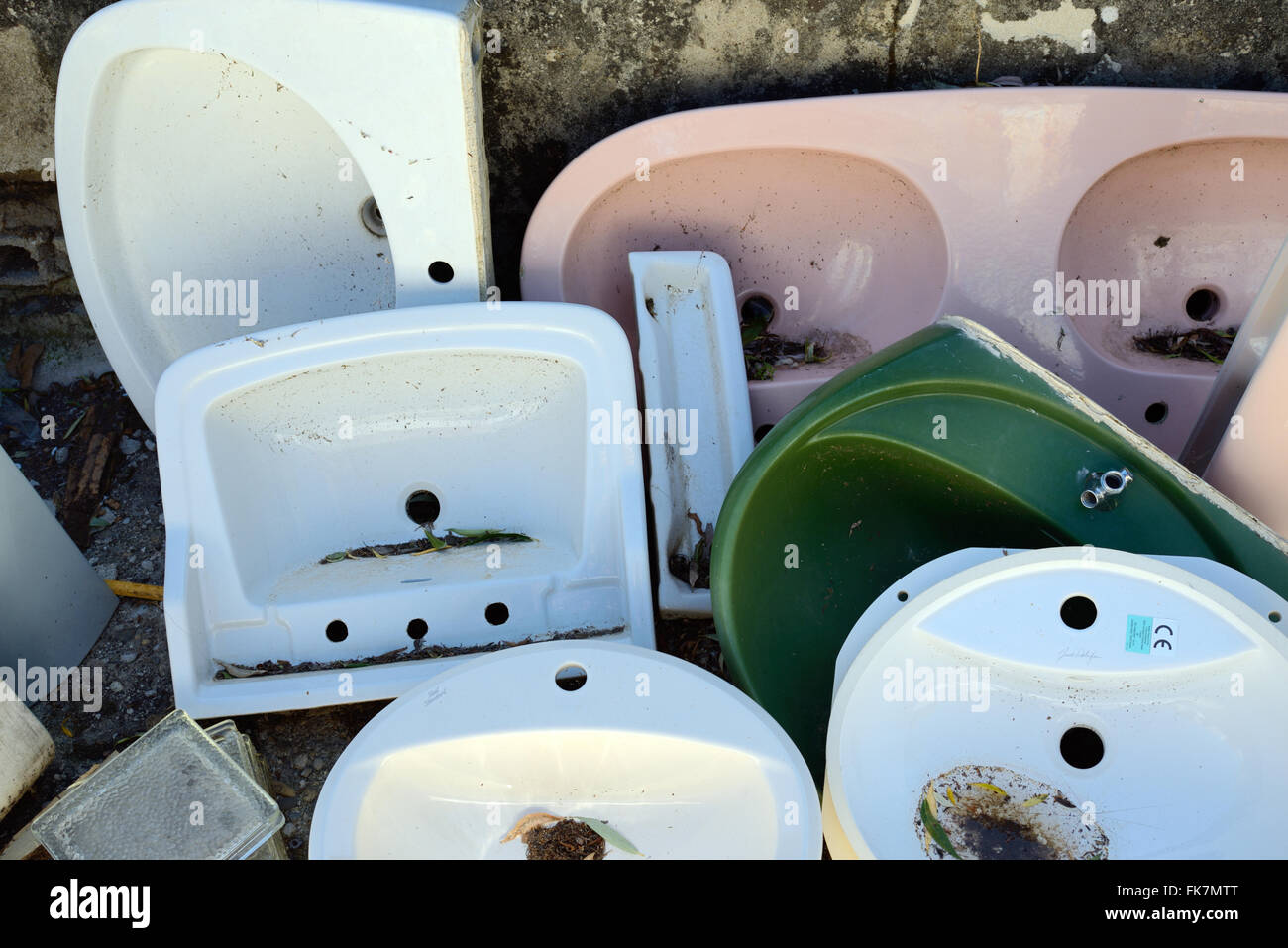 Recycled Secondhand or Second-Hand Old Bathroom Fittings and Sinks - Stock Image